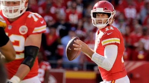Kansas City Chiefs quarterback Alex Smith (11) looks for a receiver during the first half of an NFL football game against the Pittsburgh Steelers in Kansas City, Mo., Sunday, Oct. 15, 2017. (AP Photo/Charlie Riedel)