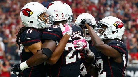 Arizona Cardinals running back Adrian Peterson (23) celebrates his touchdown against the Tampa Bay Buccaneers with wide receiver Larry Fitzgerald (11), wide receiver John Brown (12), and other teammates during the first half of an NFL football game Sunday, Oct. 15, 2017, in Glendale, Ariz. (AP Photo/Ralph Freso)