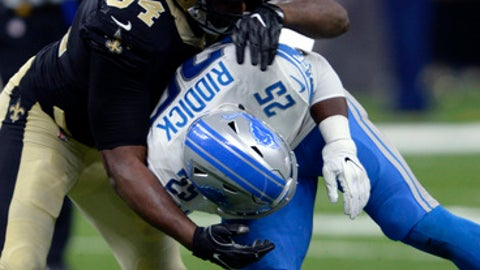New Orleans Saints defensive end Cameron Jordan (94) forces Detroit Lions running back Theo Riddick (25) to to lose the football on a pass play, resulting in an interception in the second half of an NFL football game in New Orleans, Sunday, Oct. 15, 2017. (AP Photo/Bill Feig)