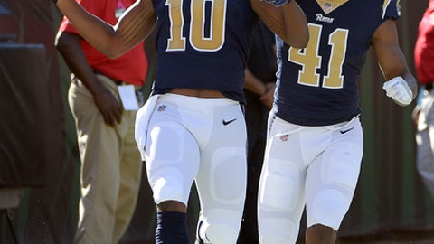 Los Angeles Rams' Pharoh Cooper (10) celebrates his 103-yard touchdown kickoff return against the Jacksonville Jaguars with defensive back Marqui Christian (41)during the first half of an NFL football game, Sunday, Oct. 15, 2017, in Jacksonville, Fla. (AP Photo/Phelan M. Ebenhack)