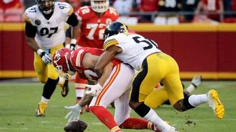 Kansas City Chiefs tight end Travis Kelce (87) fumbles the ball and later recovers it, as he is tackled by Pittsburgh Steelers linebacker Ryan Shazier (50) during the second half of an NFL football game in Kansas City, Mo., Sunday, Oct. 15, 2017. (AP Photo/Charlie Riedel)