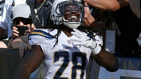 Los Angeles Chargers running back Melvin Gordon (28) celebrates in front of Oakland Raiders fans after scoring a touchdown during the second half of an NFL football game in Oakland, Calif., Sunday, Oct. 15, 2017. (AP Photo/D. Ross Cameron)