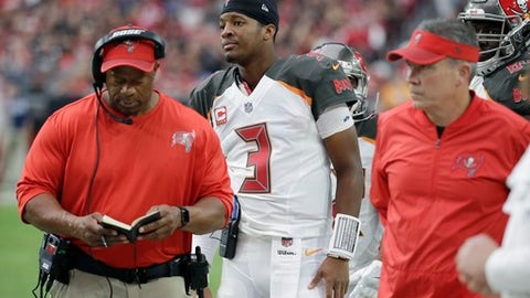 An injured Tampa Bay Buccaneers quarterback Jameis Winston (3) watches the game from the sidelines during the second half of an NFL football game against the Arizona Cardinals, Sunday, Oct. 15, 2017, in Glendale, Ariz. The Cardinals defeated the Buccaneers 38-33. (AP Photo/Rick Scuteri)