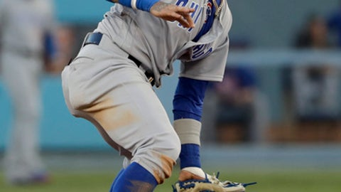 Chicago Cubs second baseman Javier Baez, top, tags out Los Angeles Dodgers' Yasiel Puig stealing during the fourth inning of Game 2 of baseball's National League Championship Series in Los Angeles, Sunday, Oct. 15, 2017. (AP Photo/Matt Slocum)