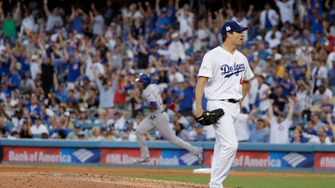 Chicago Cubs' Addison Russell, left, rounds the bases after a home run off Los Angeles Dodgers starting pitcher Rich Hill during the fifth inning of Game 2 of baseball's National League Championship Series in Los Angeles, Sunday, Oct. 15, 2017. (AP Photo/Matt Slocum)