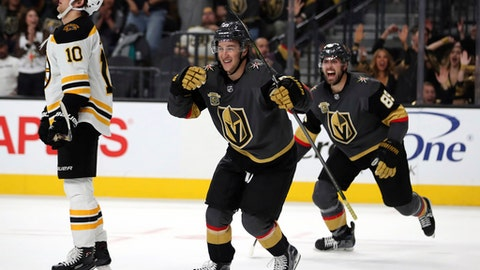 Vegas Golden Knights left wing Brendan Leipsic (13) and Vegas Golden Knights right wing Alex Tuch (89) celebrate a goal over the Boston Bruins during the second period of an NHL hockey game at T-Mobile Arena, Sunday, Oct. 15, 2017, in Las Vegas. (AP Photo/L.E. Baskow)