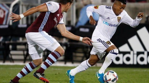Real Salt Lake forward Joao Plata, right, drives past Colorado Rapids defender Mike da Fonte in the second half of an MLS soccer match Sunday, Oct. 15, 2017, in Commerce City, Colo. The Rapids won 1-0. (AP Photo/David Zalubowski)