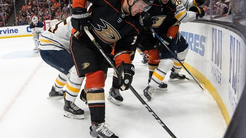Anaheim Ducks left wing Nick Ritchie, front, works the puck along the boards during the second period of an NHL hockey game against the Buffalo Sabres in Anaheim, Calif., Sunday, Oct. 15, 2017. (AP Photo/Kyusung Gong)