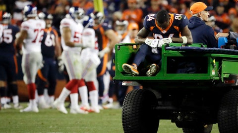 Denver Broncos wide receiver Isaiah McKenzie is carted off the field after an injury during the second half of an NFL football game against the New York Giants Sunday, Oct. 15, 2017, in Denver. (AP Photo/Jack Dempsey)