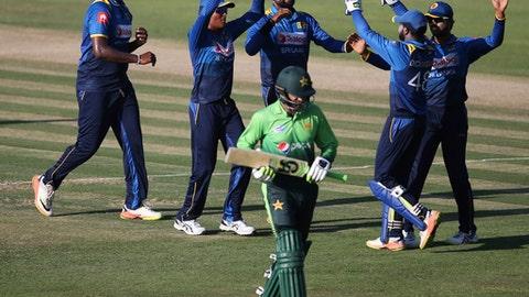 Sri Lanka's bowler Thisara Perera, 1st left, celebrates with his team-mates dismissal of Pakistan's Shoaib Malik during their second ODI cricket match in Abu Dhabi, United Arab Emirates, Monday, Oct. 16, 2017. (AP Photo/Kamran Jebreili)