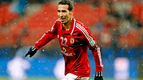FILE - In this Dec. 9, 2012 file photo, Al-Ahly SC's Mohamed Aboutrika celebrates after scoring a goal against Sanfrecce Hiroshima during their quarterfinal at the FIFA Club World Cup soccer tournament in Toyota, Japan. A social media campaign to persuade former star midfielder Aboutrika to come out of retirement - and exile - to join Egypt's World Cup squad in Russia has stirred a storm in a country where politics and football often mix. The hugely popular Aboutrika already said no to a comeback, but pro-government media, seething over the show of love for the retired player, continues to vilify him over alleged ties to an outlawed Islamist group. (AP Photo/Shuji Kajiyama, File)