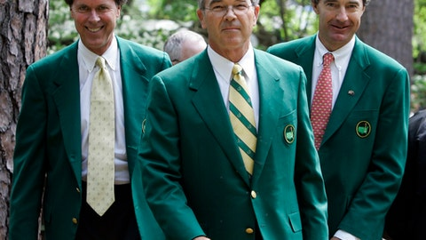 FILE - In this Wednesday, April 4, 2007, file photo, Augusta National Golf Club Chairman Billy Payne, center, arrives with Fred Ridley, left, and Craig Heatley, to brief reporters during practice for the 2007 Masters golf tournament at Augusta National Golf Club in Augusta, Ga. Fred Ridley's history with Augusta National goes back 40 years to when he played the Masters as the U.S. Amateur champion. On Monday, Oct. 16, 2017, the 65-year-old attorney took over as the seventh chairman in club history. (AP Photo/Rob Carr, File)