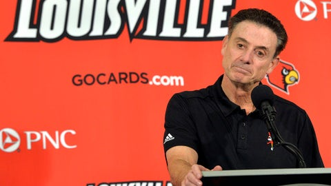 FILE - In this Oct. 3, 2015, file photo, Louisville head coach Rick Pitino responds to a question following an NCAA college basketball team's intrasquad scrimmage in Louisville, Ky. Louisville's Athletic Association has officially fired coach Rick Pitino, Monday, Oct. 16, 2017,  nearly three weeks after the school acknowledged that its men's basketball program is being investigated as part of a federal corruption probe.(AP Photo/Timothy D. Easley, File)