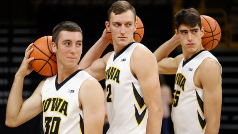 Iowa freshmen Connor McCaffery, from left, Jack Nunge and Luka Garza pose for photographers during Iowa's annual college basketball media day, Monday, Oct. 16, 2017, in Iowa City, Iowa. (AP Photo/Charlie Neibergall)