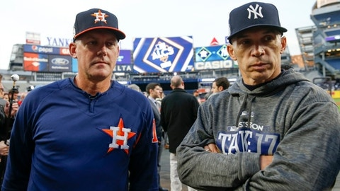 New York Yankees manager Joe Girardi talks to Houston Astros manager A.J. Hinch before Game 3 of baseball's American League Championship Series Monday, Oct. 16, 2017, in New York. (AP Photo/Kathy Willens)