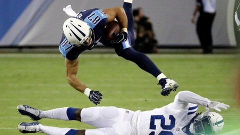 Tennessee Titans wide receiver Eric Decker (87) is brought down by Indianapolis Colts free safety Malik Hooker (29) in the first half of an NFL football game Monday, Oct. 16, 2017, in Nashville, Tenn. (AP Photo/James Kenney)