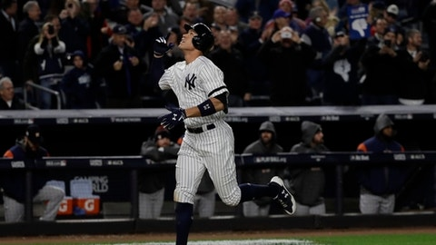 New York Yankees' Aaron Judge hits a three-run home run during the fourth inning of Game 3 of baseball's American League Championship Series against the Houston Astros Monday, Oct. 16, 2017, in New York. (AP Photo/David J. Phillip)