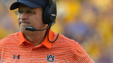 FILE - In this Oct. 14, 2017, file photo, Auburn head coach Gus Malzahn reacts as his team falls behind to LSU in the second half during an NCAA college football game in Baton Rouge, La. Malzahn and No. 21 Auburn were sitting pretty, ranked in the Top 10 and up 20-0 at LSU. Then they flopped, renewing fans' criticism of Malzahn and the offense. LSU defeated Auburn 27-23. (AP Photo/Matthew Hinton, File)