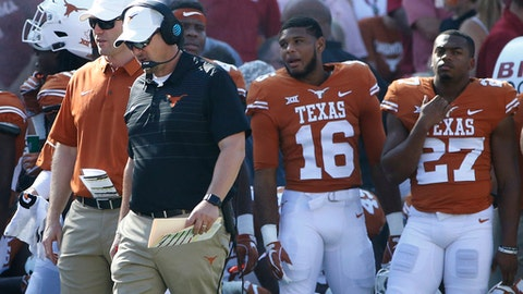 "FILE - In this Oct. 14, 2017, file photo, Texas head coach Tom Herman walks the sidelines as Texas plays Oklahoma during the second half of an NCAA college football game, in Dallas. Midway through a first season most notable for two close losses, an emerging freshman quarterback and an off-hand ""fairy dust"" comment, Tom Herman has a 3-3 team that's not really any closer to reaching a bowl game than Charlie Strong's last one was. (AP Photo/Ron Jenkins, File)"