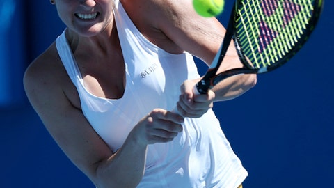 FILE - In this Jan. 15, 2013, file photo, Canada's Rebecca Marino hits a backhand return to China's Peng Shuai during their first round match at the Australian Open tennis championship in Melbourne, Australia. Former top-50 tennis player Rebecca Marino will come out of retirement after more than 4½ years and enter a pair of tournaments. Tennis Canada announced Monday, Oct. 16, 2017, that the 26-year-old Marino will appear in events at Saguenay and Toronto. Marino left professional tennis in February 2013, and said she had been dealing with depression. (AP Photo/Aaron Favila, File)
