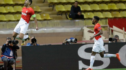 Monaco's Radamel Falcao celebrates scoring the opening goal while his teammate Thomas Lemar looks on during the Champions League Group G first leg soccer match between Monaco and Besiktas at Louis II stadium in Monaco, Tuesday, Oct. 17, 2017. (AP Photo/Claude Paris)
