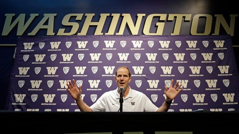 New Washington men's basketball coach Mike Hopkins addresses media members during the team's media day Tuesday, Oct. 17, 2017, in Seattle. (AP Photo/Elaine Thompson)