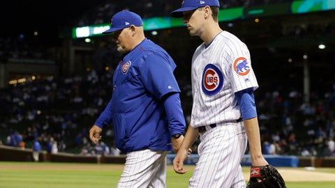 Chicago Cubs' Kyle Hendricks, right, walks to bullpen to warm up with pitching coach Chris Bosio before Game 3 of baseball's National League Championship Series against the Los Angeles Dodgers, Tuesday, Oct. 17, 2017, in Chicago. (AP Photo/Nam Y. Huh)