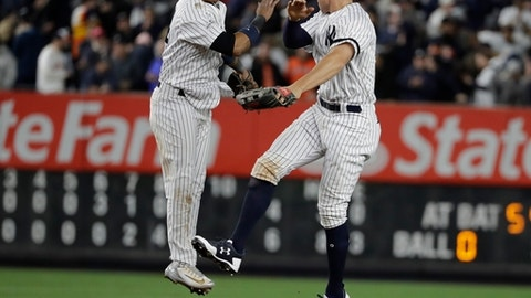 New York Yankees' Starlin Castro and Aaron Judge celebrate after Game 4 of baseball's American League Championship Series against the Houston Astros Tuesday, Oct. 17, 2017, in New York. The Yankees won 6-4 to tie the series at 2-2. (AP Photo/David J. Phillip)