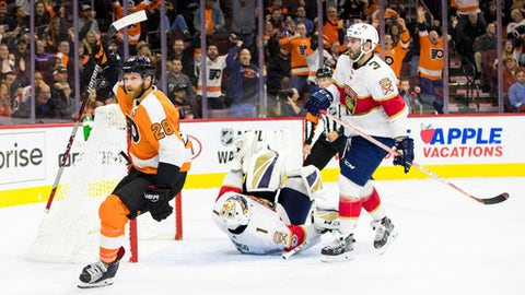 Philadelphia Flyers' Claude Giroux, left, reacts to his goal on Florida Panthers' Roberto Luongo, center, as Keith Yandle, right, looks on during the second period of an NHL hockey game, Tuesday, Oct. 17, 2017, in Philadelphia. (AP Photo/Chris Szagola)