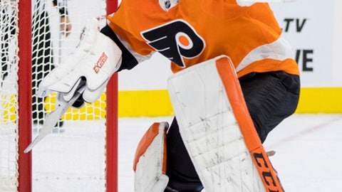 Philadelphia Flyers' Michal Neuvirth, of the Czech Republic, catches the puck with his glove during the third period of an NHL hockey game against the Florida Panthers, Tuesday, Oct. 17, 2017, in Philadelphia. The Flyers won 5-1. (AP Photo/Chris Szagola)