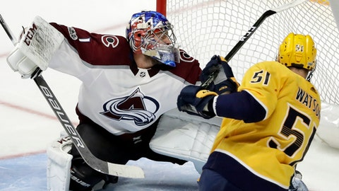Nashville Predators left wing Austin Watson (51) scores a goal against Colorado Avalanche goalie Semyon Varlamov (1), of Russia, in the third period of an NHL hockey game Tuesday, Oct. 17, 2017, in Nashville, Tenn. (AP Photo/Mark Humphrey)
