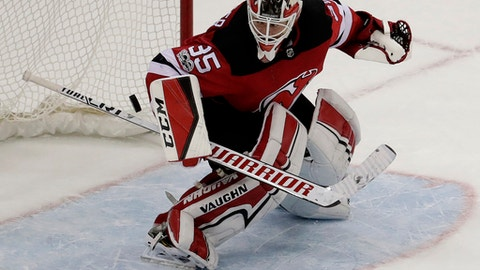 New Jersey Devils goalie Cory Schneider (35) blocks a shot by Tampa Bay Lightning right wing Ryan Callahan, not pictured, during a shootout in an NHL hockey game, Tuesday, Oct. 17, 2017, in Newark, N.J. The Devils won 5-4 in a shootout. (AP Photo/Julio Cortez)