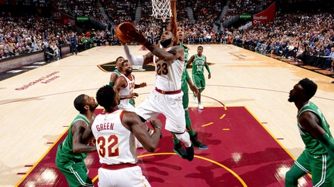 CLEVELAND, OH - OCTOBER 17:  LeBron James #23 of the Cleveland Cavaliers goes to the basket against the Boston Celtics on October 17, 2017 at Quicken Loans Arena in Cleveland, Ohio. NOTE TO USER: User expressly acknowledges and agrees that, by downloading and/or using this Photograph, user is consenting to the terms and conditions of the Getty Images License Agreement. Mandatory Copyright Notice: Copyright 2017 NBAE (Photo by Jesse D. Garrabrant/NBAE via Getty Images)