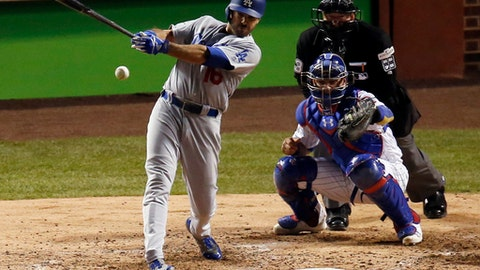 Los Angeles Dodgers' Andre Ethier (16) hits a single during the sixth inning of Game 3 of baseball's National League Championship Series against the Chicago Cubs, Tuesday, Oct. 17, 2017, in Chicago. (AP Photo/Charles Rex Arbogast)