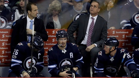 Winnipeg Jets head coach Paul Maurice, top right, watches a replay after the Columbus Blue Jackets scored during the third period of an NHL hockey game in Winnipeg, Manitoba, Tuesday, Oct. 17, 2017. The Blue Jackets won, 5-2. (Trevor Hagan/The Canadian Press via AP)