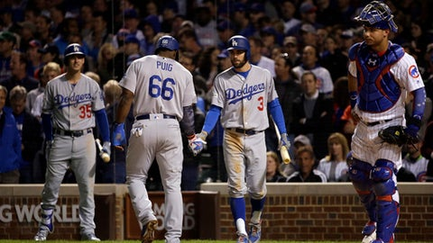 Los Angeles Dodgers' Yasiel Puig celebrates with Chris Taylor (3) after scoring a run during the sixth inning of Game 3 of baseball's National League Championship Series against the Chicago Cubs, Tuesday, Oct. 17, 2017, in Chicago. (AP Photo/Nam Y. Huh)