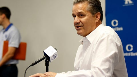 In this Oct. 12, 2017, photo, Kentucky head coach John Calipari speaks to the media during the school's NCAA college basketball media day in Lexington, Ky. Southeastern Conference teams should have plenty to boast about at their annual event to meet with media and discuss the upcoming season. Defending league champion Kentucky should garner much of the preseason attention at this year's Tipoff event. (AP Photo/James Crisp)