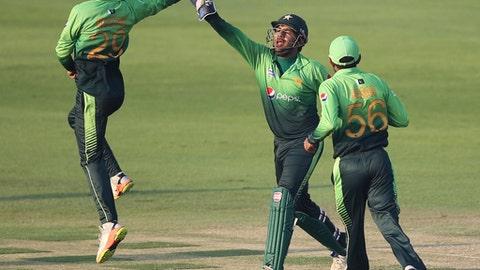 Pakistan's bowler Shadab Khan celebrates with Sarfaraz Ahmed dismissal of Sri Lanka's Dinesh Chandimal during their third ODI cricket match in Abu Dhabi, United Arab Emirates, Wednesday, Oct. 18, 2017. (AP Photo/Kamran Jebreili)
