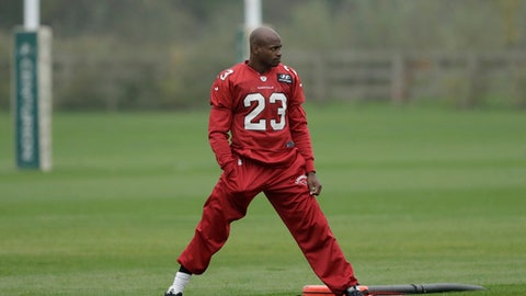Arizona Cardinals running back Adrian Peterson takes part an NFL training session at the London Irish rugby team training ground in the Sunbury-onThames suburb of south west London, Wednesday, Oct. 18, 2017. The Arizona Cardinals are preparing for an NFL regular season game against the Los Angeles Rams at London's Wembley stadium on Sunday. (AP Photo/Matt Dunham)