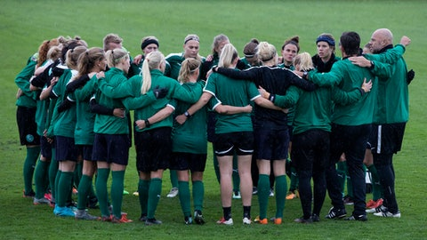 The Danish national women's soccer team huddle together before training in Dragor, outside Copenhagen Wednesday Oct. 18 2017.  A pay dispute involving the Danish women's national team has forced the country's soccer federation to cancel the upcoming Friday World Cup qualifying match against Sweden. (Finn Frandsen/AP via ritzau)