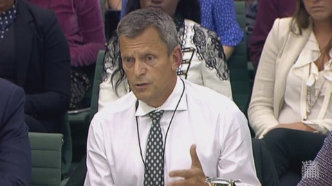 FA Chief Executive Martin Glenn answers in front of the Digital, Culture, MediaCulture, Media and Sport Committee at Portcullis House in Westminster, London, Wednesday, Oct. 18, 2017. A fresh investigation into the conduct of fired national women's soccer team coach Mark Sampson found that he directed discriminatory comments at players Eniola Aluko and Drew Spence, the English Football Association said Wednesday. (PA via AP)