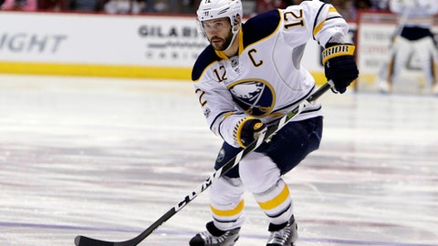 FILE - In this Feb. 26, 2017, file photo, then-Buffalo Sabres right wing Brian Gionta (12) skates in the first period during an NHL hockey game against the Arizona Coyotes, in Glendale, Ariz. USA Hockey revealed its roster for the upcoming Deutschland Cup, the best indication so far of what the Olympic team will look like without NHL players.The 29-player roster includes Gionta. (AP Photo/Rick Scuteri, File)