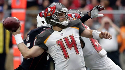 FILE - In this Sunday, Oct. 15, 2017, file photo, Tampa Bay Buccaneers quarterback Ryan Fitzpatrick (14) throws a pass during the first half of an NFL football game against the Arizona Cardinals in Glendale, Ariz. With Jameis Winston's status uncertain because of an injured throwing shoulder, the Buccaneers begin preparation for the Buffalo Bills with Fitzpatrick at quarterback.  (AP Photo/Rick Scuteri, FIle)