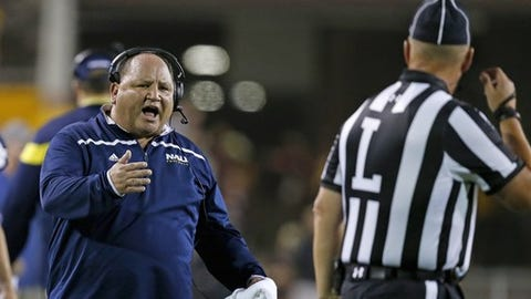 Northern Arizona coach Jerome Souers, left, argues with line judge Steven Kovac during the first half of an NCAA college football game against Arizona State on Saturday, Sept. 3, 2016, in Tempe, Ariz. (AP Photo/Ross D. Franklin)