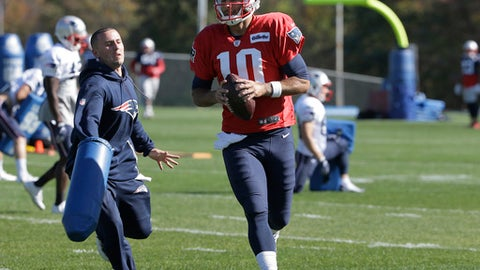 New England Patriots quarterback Jimmy Garoppolo (10) performs field drills during NFL football practice, Wednesday, Oct. 18, 2017, in Foxborough, Mass. (AP Photo/Steven Senne)