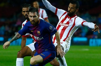 Messi nets 100th goal in Europe, Barca beats Olympiakos 3-1