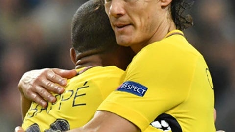 PSG's Edinson Cavani is hugged by PSG's Kylian Mbappe after he scored his side's second goal during a Champions League Group B soccer match between Anderlecht and Paris Saint-Germain at the Constant Vanden Stock stadium in Brussels, Belgium, Wednesday, Oct. 18, 2017. (AP Photo/Geert Vanden Wijngaert)