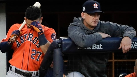 Houston Astros manager A.J. Hinch watches as Jose Altuve waits to bat during the third inning of Game 5 of baseball's American League Championship Series against the New York Yankees Wednesday, Oct. 18, 2017, in New York. (AP Photo/David J. Phillip)