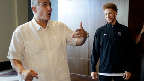 South Carolina's Hassani Gravett, right, listens as head coach Frank Martin tells a story outside the interview room at the Southeastern Conference men's NCAA college basketball media day, Wednesday, Oct. 18, 2017, in Nashville, Tenn. (AP Photo/Mark Humphrey)