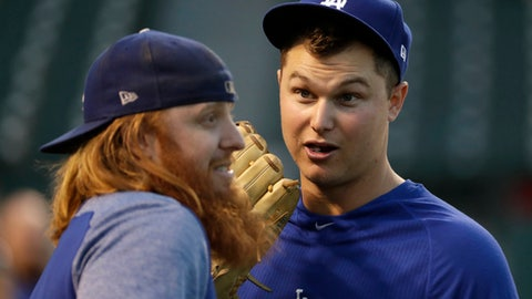 Los Angeles Dodgers' Justin Turner, left, and Joc Pederson talk as they warm up before Game 4 of baseball's National League Championship Series against the Chicago Cubs, Wednesday, Oct. 18, 2017, in Chicago. (AP Photo/Matt Slocum)